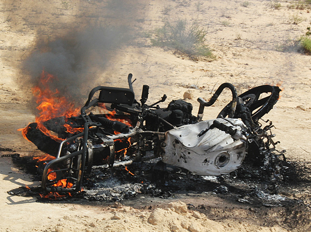 A motorbike burns following a raid by Egyptian security forces on the village of El-Jurah in Egypt's North Sinai province on Aug. 12. Six gunmen were killed in the raid.