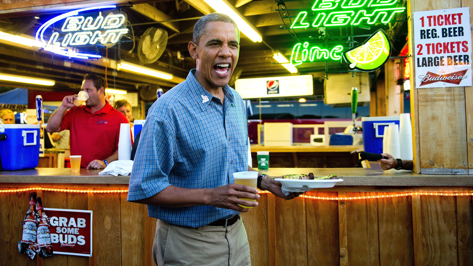 President Barack Obama gets a beer and a pork chop as he visits the Iowa State Fair in Des Moines. Earlier, the president gave a man at a coffee shop a bottle of the White House's home brew. (AFP/Getty Images)