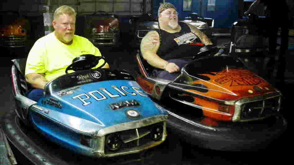 "Keith Van Brunt (left) and Tom Mgerack, known as the ""Bumper Car Psychos,"" go for a ride July 27 at the Keansburg Amusement Park in Keansburg, N.J."