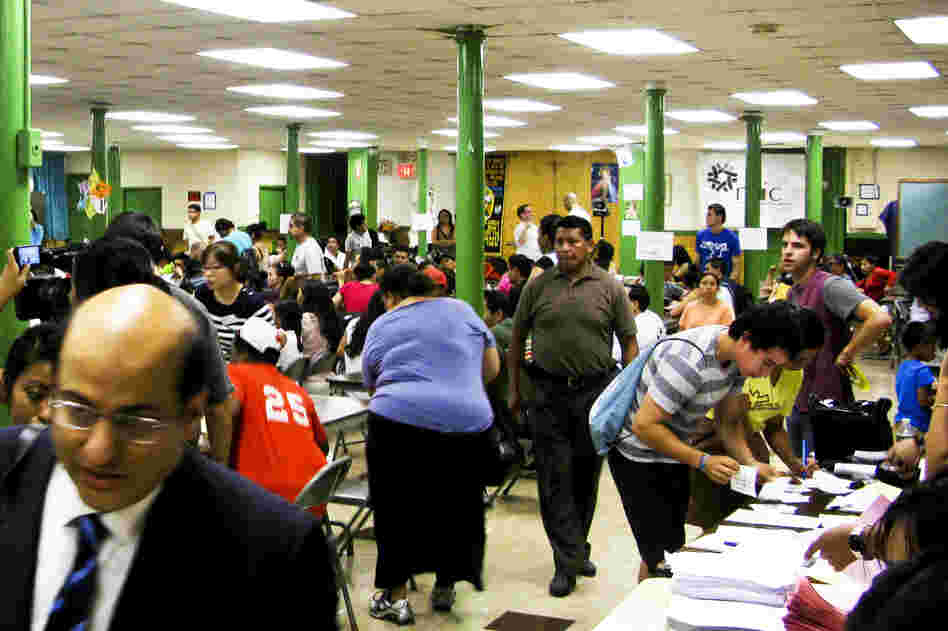 Potential applicants for President Obama's deferred action program gather at St. Mary's Church in New York for a workshop and legal advice.