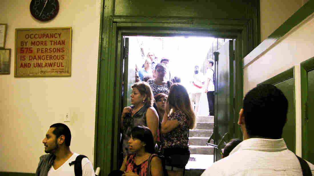 "Potential applicants line up for counseling sessions on President Obama's ""deferred action"" program at St. Mary's Church in New York."