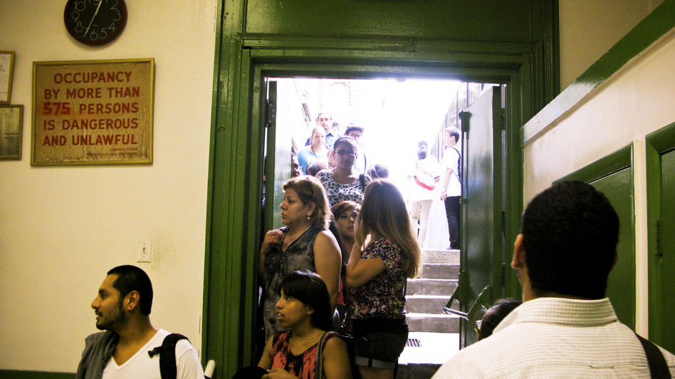 "Potential applicants line up for counseling sessions on President Obama's ""deferred action"" program at St. Mary's Church in New York. (NPR)"