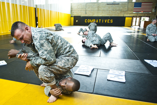 Staff Sgt. Ronald Sherwood practices a maneuver on Sgt. 1st Class Darwin Scriber at the U.S. Army Combatives School at Fort Benning, Ga. The school trains instructors who will teach recruits hand-to-hand combat. Most of the student instructors have fought in Iraq and Afghanistan. (Pouya Dianat for NPR)