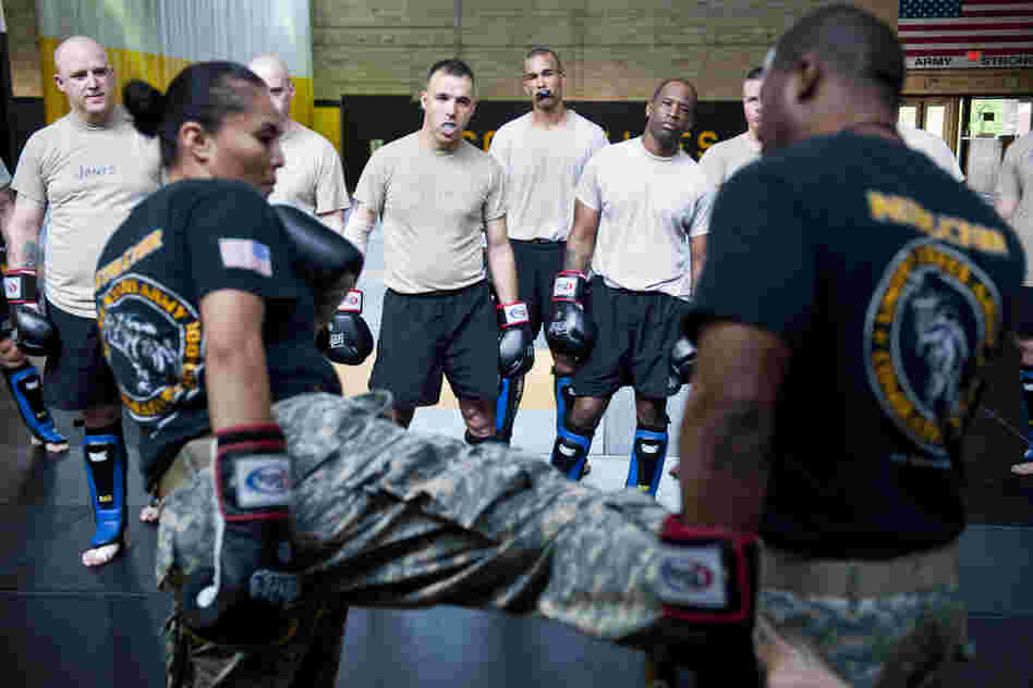 Student instructors watch combat movements before a sparring exercise at the U.S. Army Combatives school. The Army has been conducting a study to see how many soldiers sustain concussions during the training.