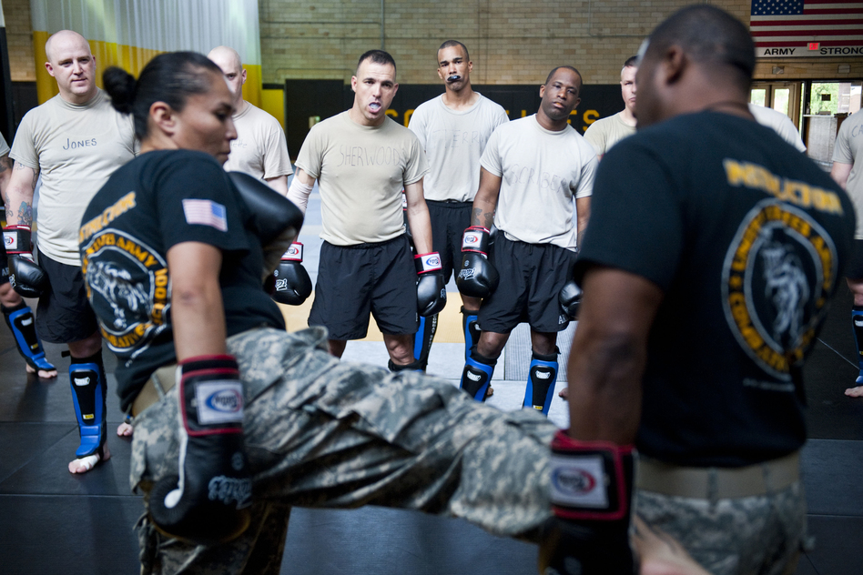 Student instructors watch combat movements before a sparring exercise at the U.S. Army Combatives school. The Army has been conducting a study to see how many soldiers sustain concussions during the training. (Pouya Dinat for NPR)