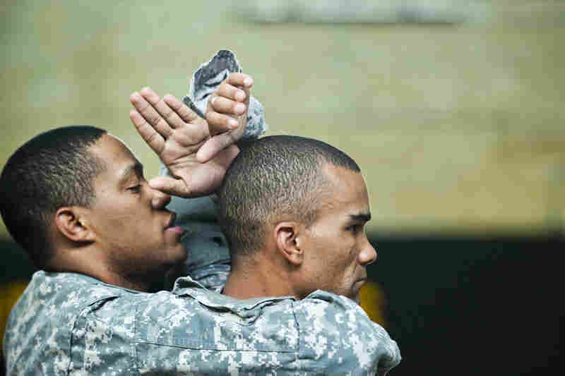 Sgt. 1st Class Isaac Cunningham (left) and Staff Sgt. Robert Terry practice maneuvers.