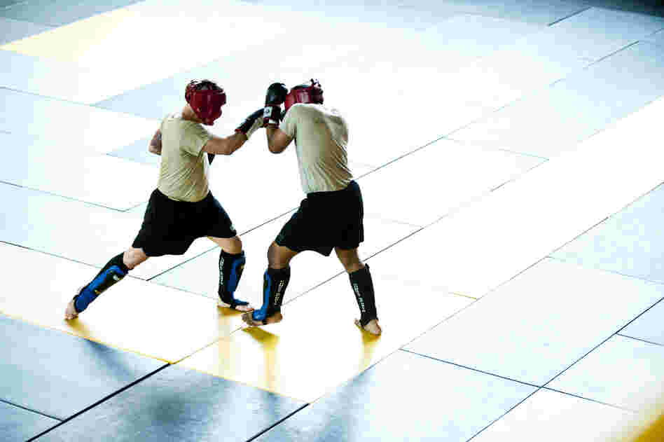 Students practice moves during a sparring session. Early findings in a research study suggest that, on average, one soldier is suffering a concussion every other day in combat classes.