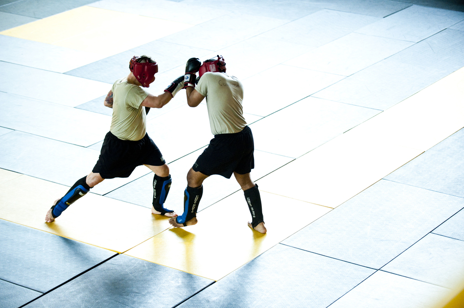 Students practice moves during a sparring session. Early findings in a research study suggest that, on average, one soldier is suffering a concussion every other day in combat classes. (Pouya Dinat for NPR)