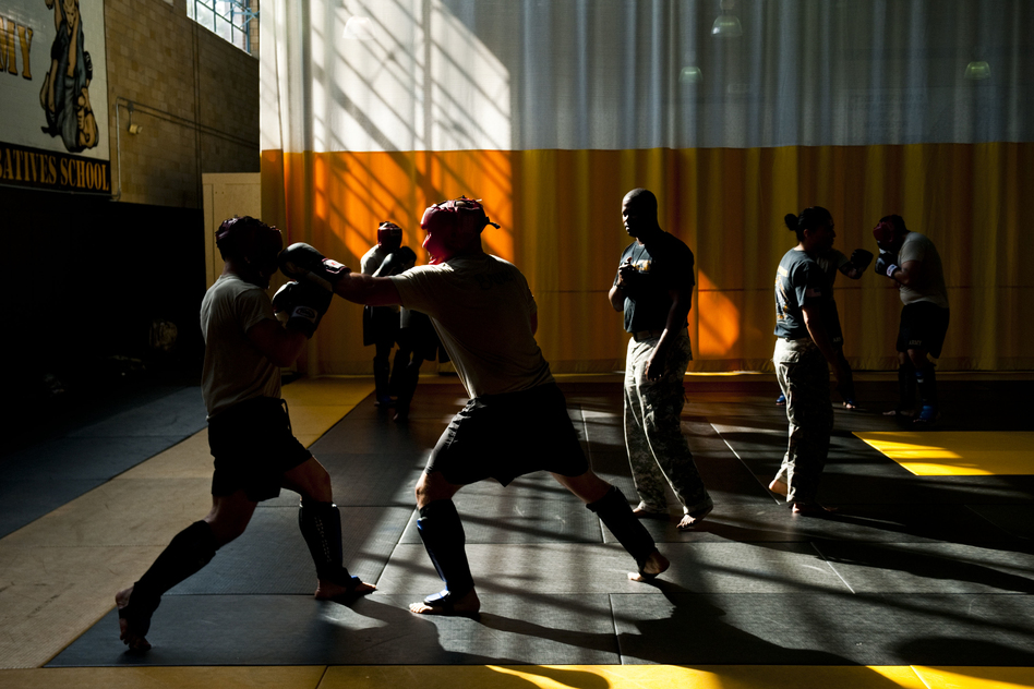 Instructors go through the gym watching the exercises. (Pouya Dinat for NPR)