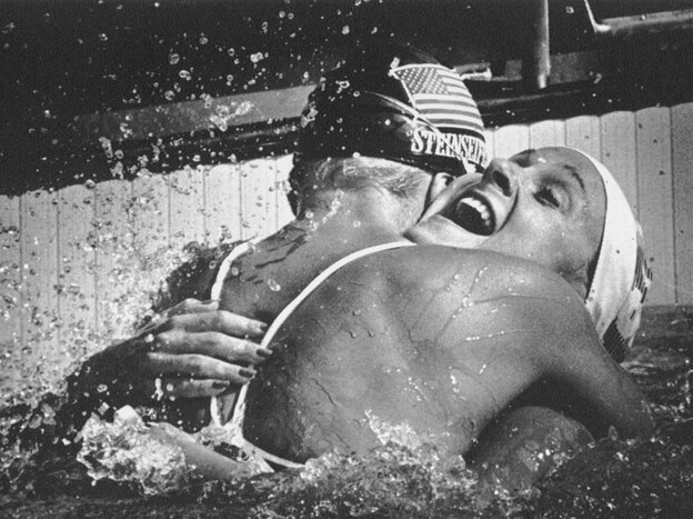 American swimmer Carrie Steinseifer, left, hugs Nancy Hogshead after they tied for the gold medal in the 100 meter freestyle competition during the 1984 Olympics. (Courtesy of Nancy Hogshead-Makar)