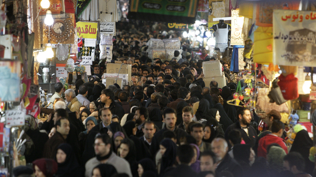 Iranians walk through the main bazaar in Tehran in January. Sanctions by the EU and U.S., plus political woes related to the Syrian uprising, have created the most serious crisis faced by Tehran since the 1980s. (AP)