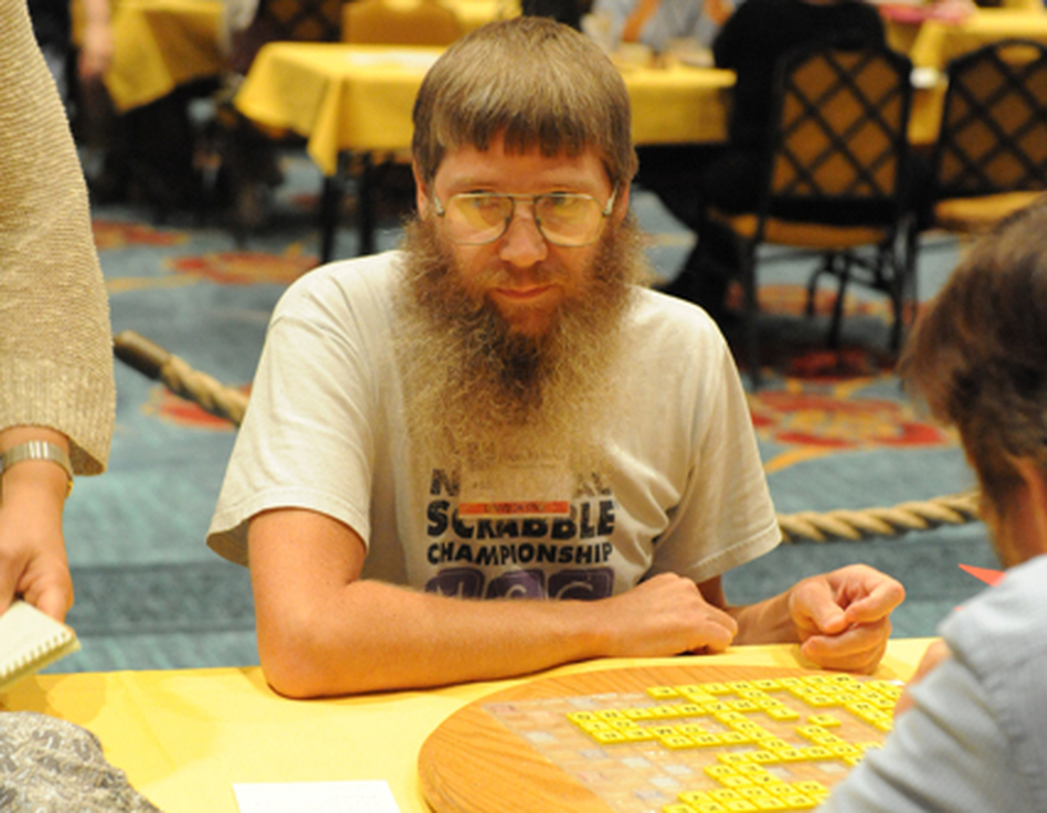 Four-time National Champion Nigel Richards. He won again today, becoming the first person to win four National Scrabble Championships and the first to win three titles in a row. A younger player, though, was caught cheating. (North American Scrabble Players Association)