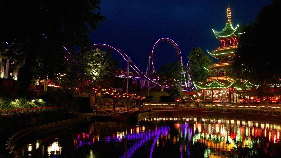 Tivoli Gardens, one of the world's oldest amusement parks, has been a landmark in Copenhagen, Denmark, since the middle of the 19th century. It remains hugely popular, particularly on summer nights.