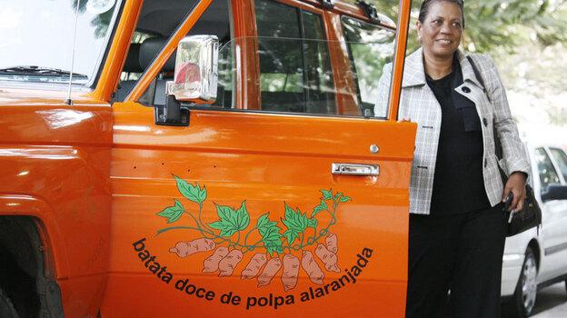 Sweet potato evangelist Maria Isabel Andrade from the International Potato Center drives around Mozambique in her orange Toyota Land Cruiser. (NPR)