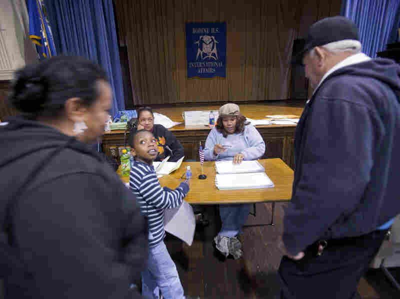 Pennsylvania voters show identification as they sign in to vote during the Republican primary in Philadelphia in April.