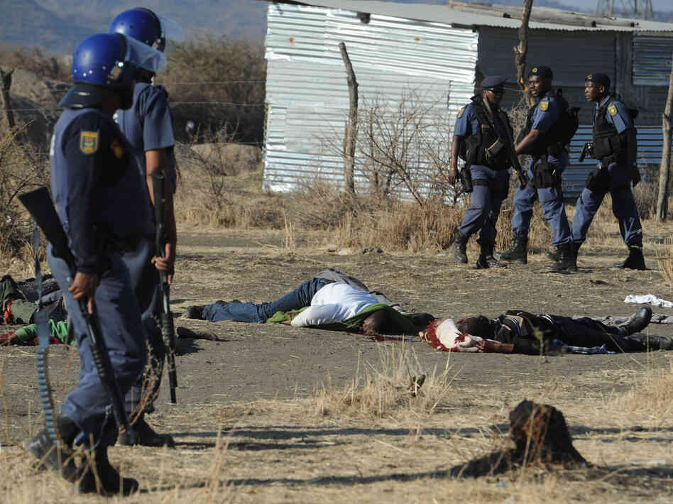 Police surround miners killed in Marikana, South Africa, on Thursday.