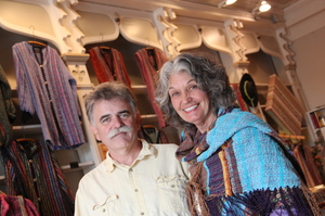 Steve Ayers, a local potter, was part of the effort 14 years ago to recruit other artists to live in Hannibal. He's shown here with Nancy Kaufman, in her shop on Main Street. Kaufman moved to Hannibal in 2005, and says as soon as she saw this old drugstore, she dreamed of turning it into a shop for her woven art.