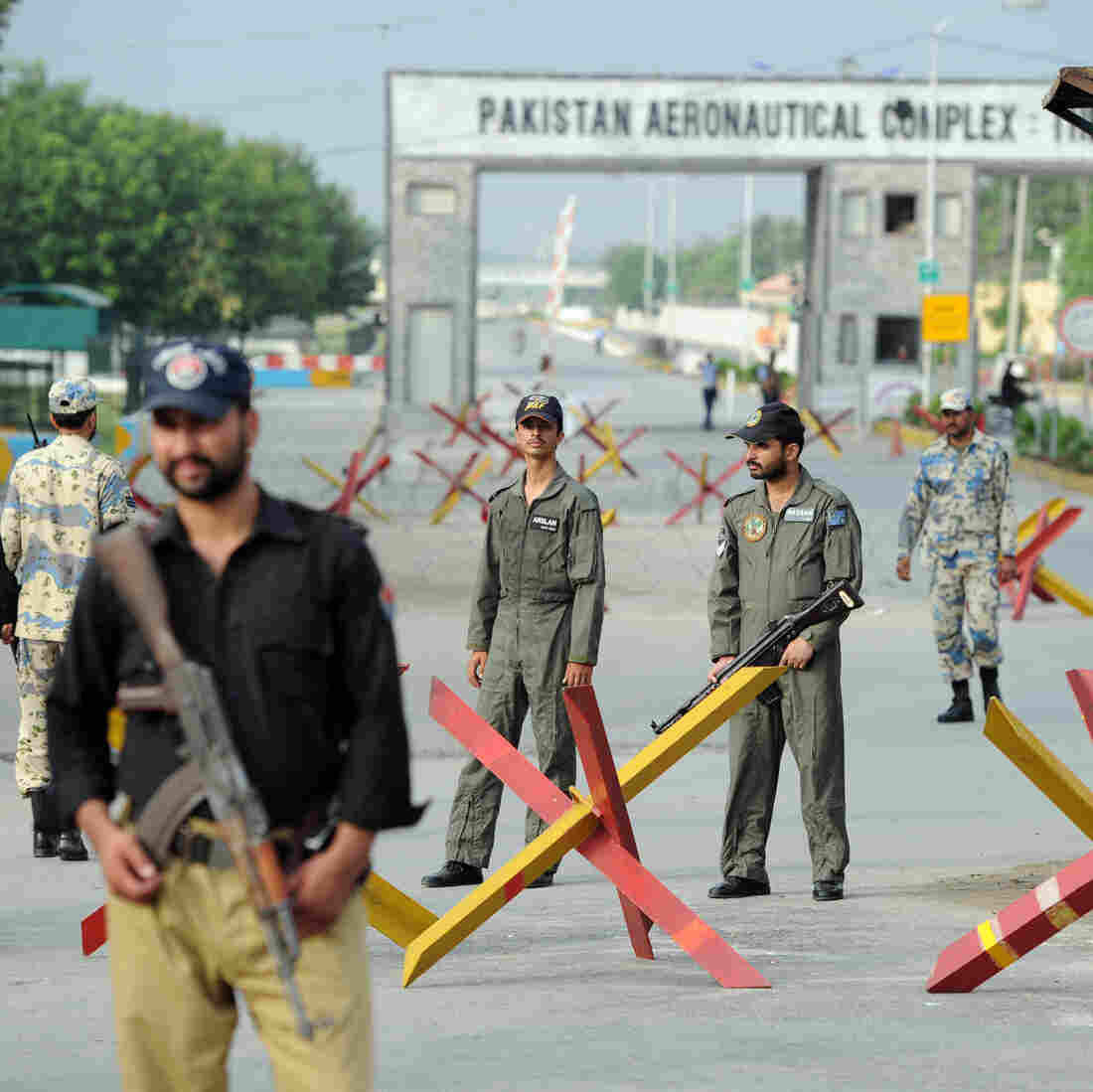 Pakistani Air Force personnel guard an air base northwest of Islamabad earlier today. It was attacked Thursday by militants armed with guns, rocket launchers and suicide vests.