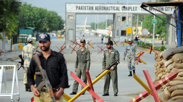 Pakistani Air Force personnel guard an air base northwest of Islamabad earlier today. It was attacked Thursday by militants armed with guns, rocket launchers and suicide vests. (AFP/Getty Images)