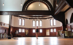 Painter Melissa Dominiak moved here from Seattle and purchased a massive church and home about two miles from Main Street in Hannibal, Mo., for $70,000. She plans to rehab the building herself and rent out the space for special events.