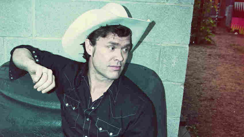 Corb Lund, who wrote most of Cabin Fever, his new album, in a cabin he built himself.