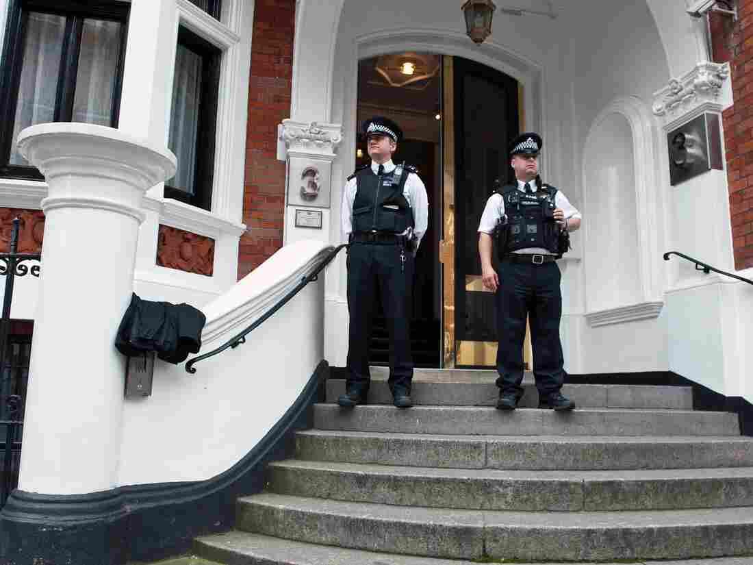 Metropolitan Police Officers outside the main door of the Ecuadorian embassy in London. WikiLeaks founder Julian Assange is inside.