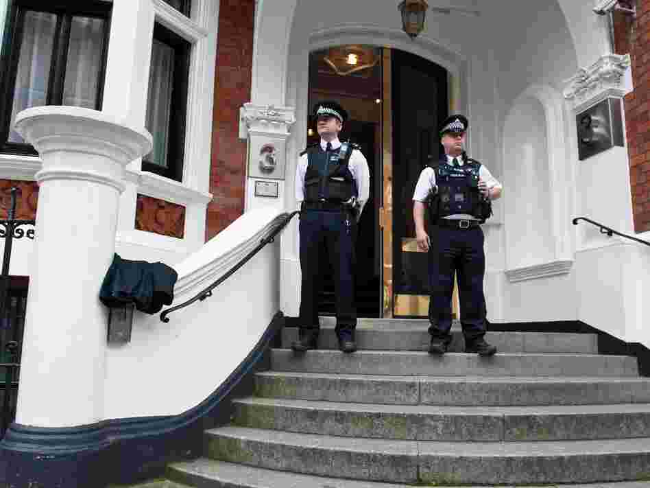 Metropolitan Police Officers outside the main door of the Ecuadorian embassy in London. WikiLeaks founder Julian Assange is inside.