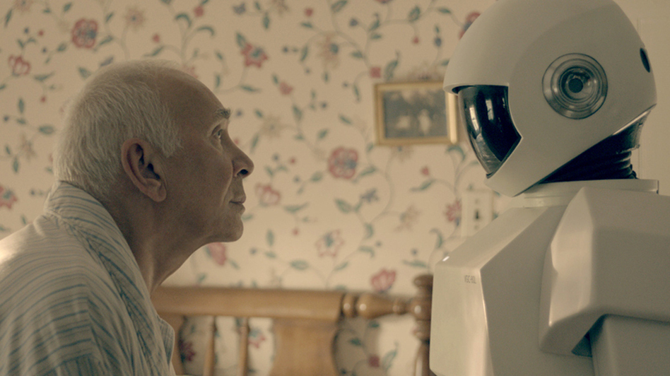 "In Robot & Frank, a robot cares for an aging ex-burglar who has dementia. Frank Langella, who plays the burglar, says his character ""becomes fond of the robot only because it is a tool for his wicked, wicked ways."" (Samuel Goldwyn Films and Stage 6 Films)"