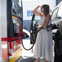 Teresa Jones tanks up in Los Angeles. The high price of crude oil, combined with refinery problems in California and the Midwest, have helped drive up the price of gas nationwide.