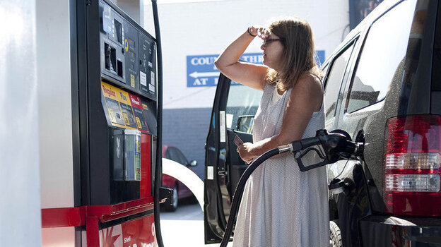 Teresa Jones tanks up in Los Angeles. The high price of crude oil, combined with refinery problems in California and the Midwest, have helped drive up the price of gas nationwide. (AP)