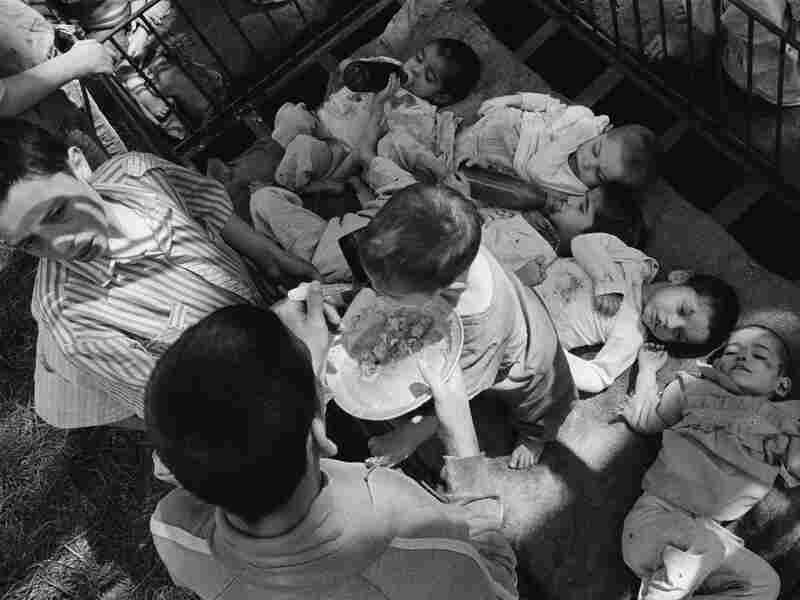 Under Romanian dictator Nicolae Ceaucescu, handicapped and orphaned children were neglected, unbathed and malnourished in orphanages throughout the country. This photo shows orphans at a state institution in Grandinari, Romania in 1989, the year Ceaucescu was overthrown and killed.