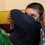 A disabled and orphaned Romanian child in his bed at the Targu Jiu orphanage in southwestern Romania in 2009. Romania has, in general, improved conditions in orphanages that provoked outrage when they were exposed internationally nearly a quarter-century ago. However, some 70,000 kids are still in the care of the state.
