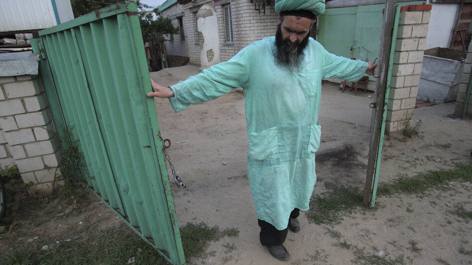 Gumar Ganiyev opens the gates of the compound where members of the Islamic sect he belongs to have lived in seclusion since the early 2000s outside Kazan, capital of the Russian province of Tatarstan, earlier this month.