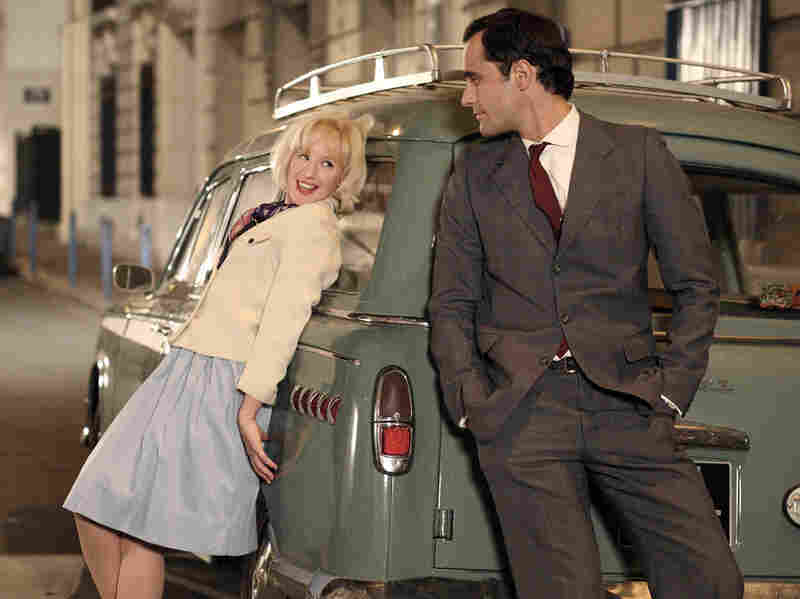 In the '60s, accidental prostitute Madeleine (Ludivine Sagnier) first encounters Czech doctor Jaromil (Rasha Bukvic). As the decades pass, they will age into Catherine Deneuve and Milos Forman.