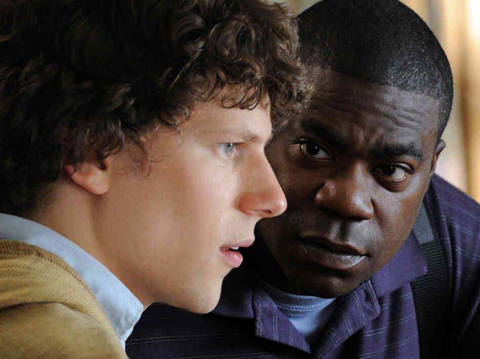 Sprinkles (Tracy Morgan) encourages Eli (Jesse Eisenberg) to shrug off the burden of his troubled family and pursue his talents as a pianist.