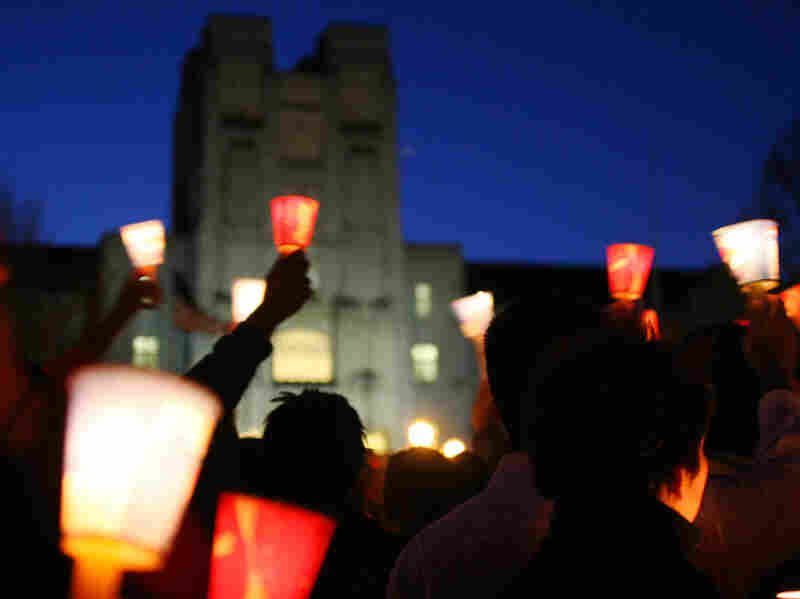 Mourners hold candles at a vigil at Virginia Tech to honor victims in a campus shooting in 2007. The shooter's name should have been in a national database, preventing him from legally buying guns, but it wasn't.