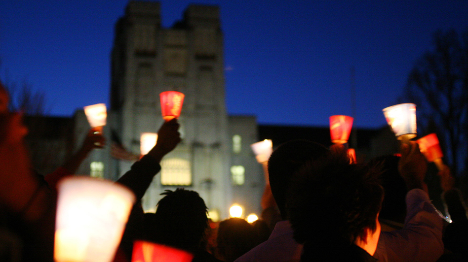 Mourners hold candles at a vigil at Virginia Tech to honor victims in a campus shooting in 2007. The shooter's name should have been in a national database, preventing him from legally buying guns, but it wasn't. (AP)