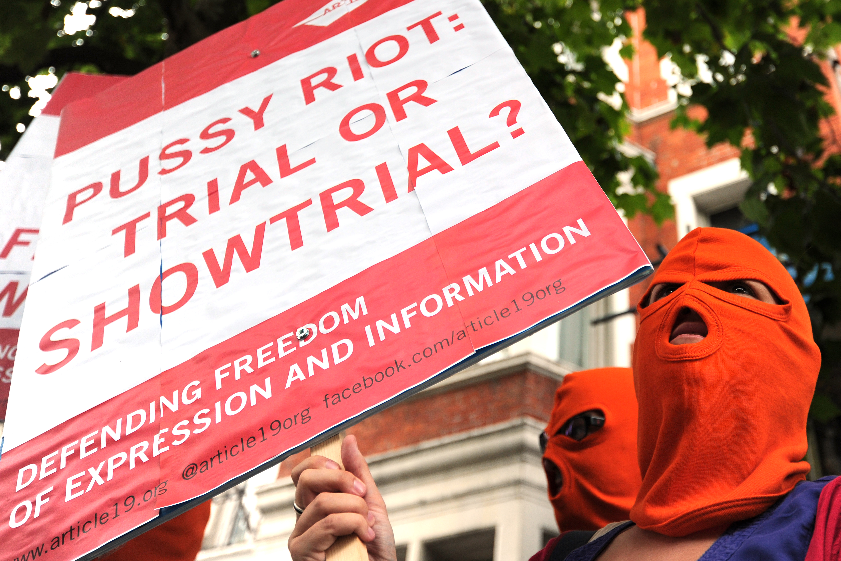 Protesters congregate near the Russian Embassy in London.