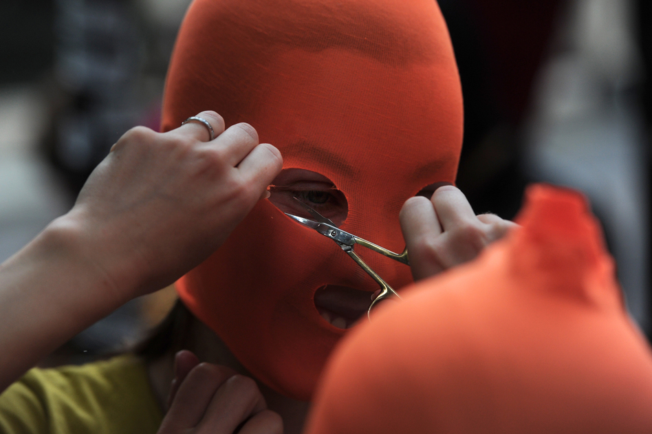 Pussy Riot supporters make masks near the Russian Embassy in London. (AFP/Getty Images)