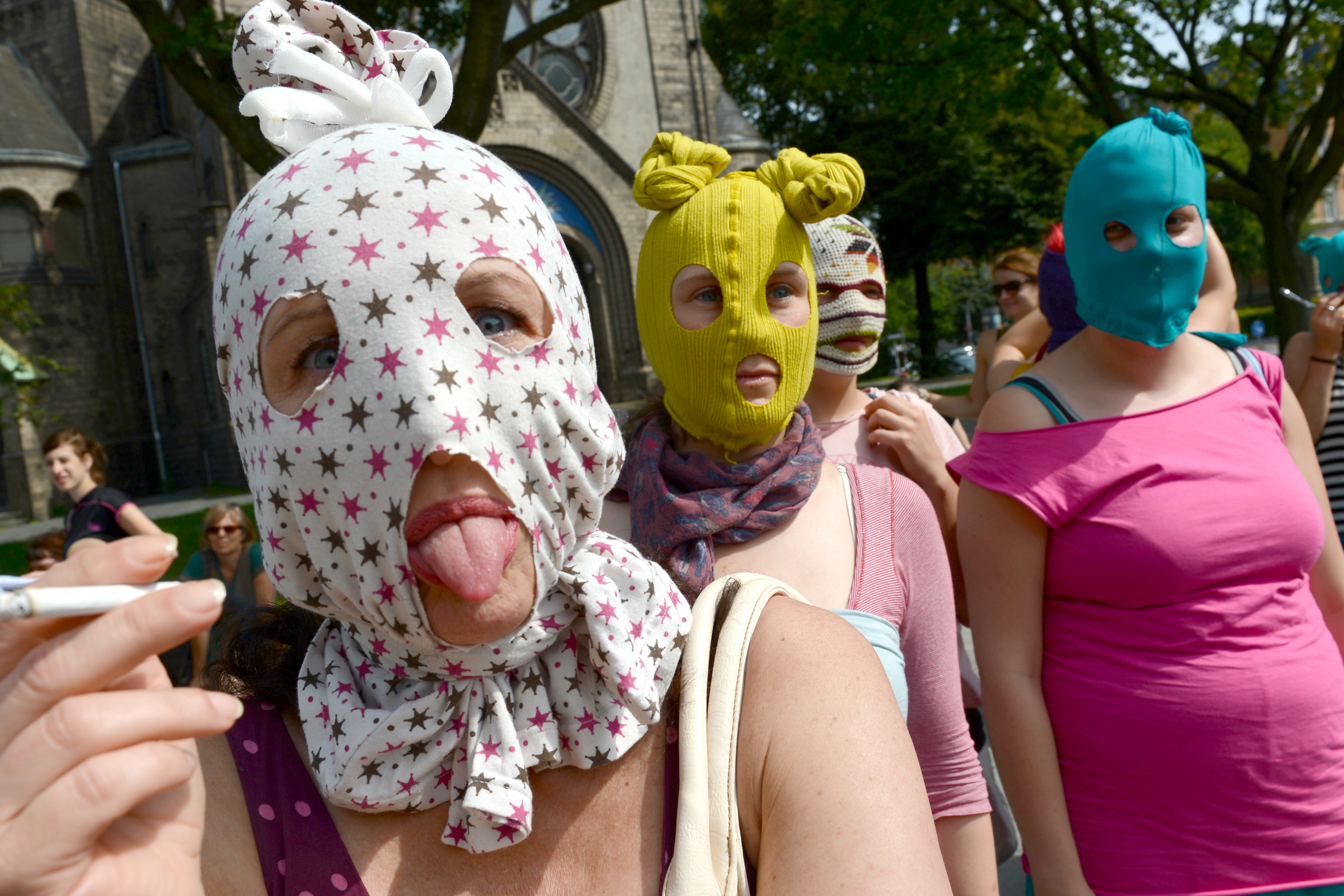 Masked supporters of Pussy Riot gather in Hamburg, Germany.
