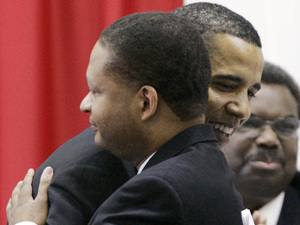 Barack Obama, then a Democratic candidate for president, hugs former U.S. Rep. Artur Davis, in Selma, Ala., in 2007.