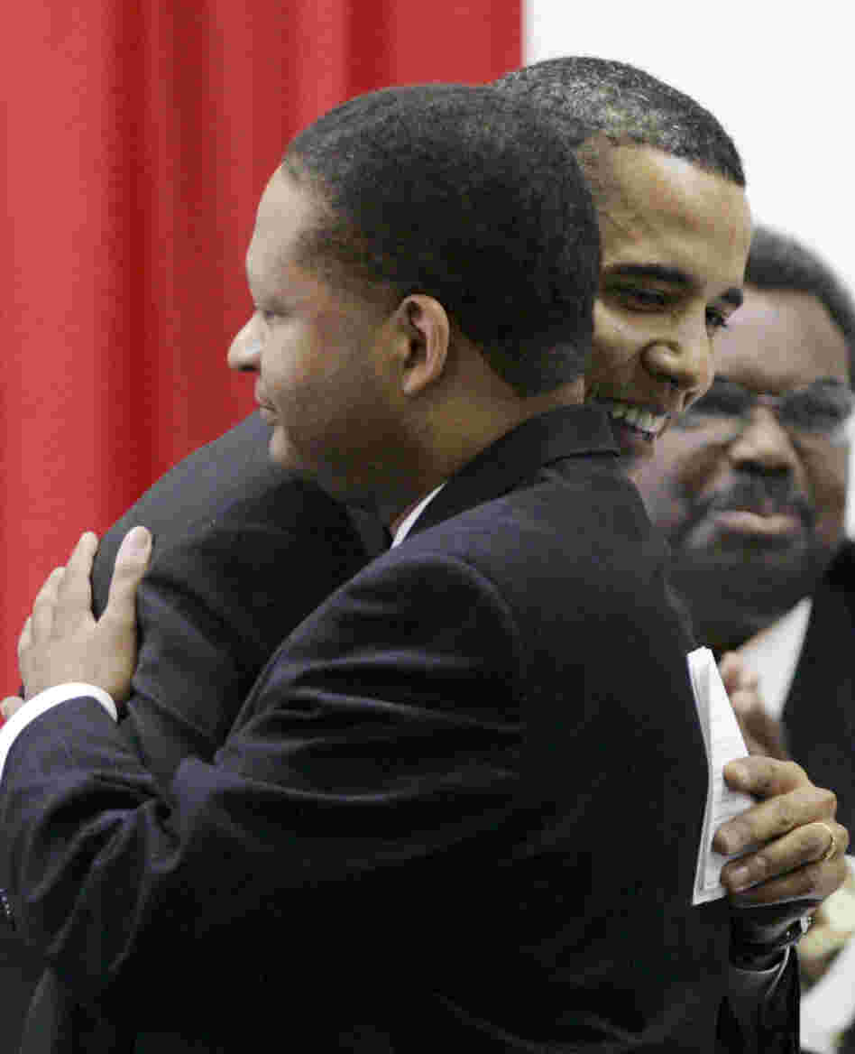 Barack Obama, then a Democratic candidate for president, hugs former U.S. Rep. Artur Davis, in Selma, Ala., in 2007.
