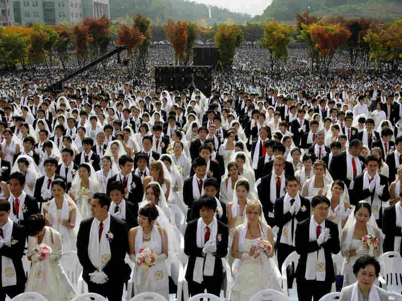 Couples from around the world participate in a mass wedding ceremony arranged by the Rev. Sun Myung Moon's Unification Church in South Korea in 2009.