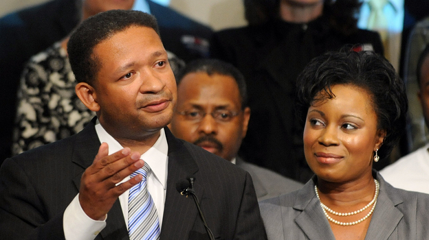 Artur Davis, with his wife, Tara, concedes the Democratic gubernatorial race in Birmingham, Ala., in 2010. Since losing that race, he has become a Republican and moved to Virginia. (AP)