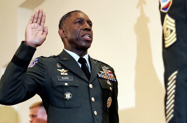 Army Lt. Gen. William E. Kip Ward is adminstered the oath of four-star General, the Army's highest rank of general.