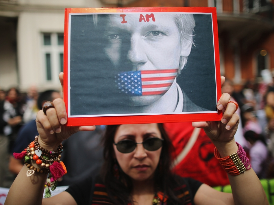 Protesters gather outside the Ecuadorian Embassy, where Wikileaks founder Julian Assange is staying, on August 16 in London, England. Assange has been living inside the embassy since June 19 to avoid extradition to Sweden to face allegations of sexual assault.