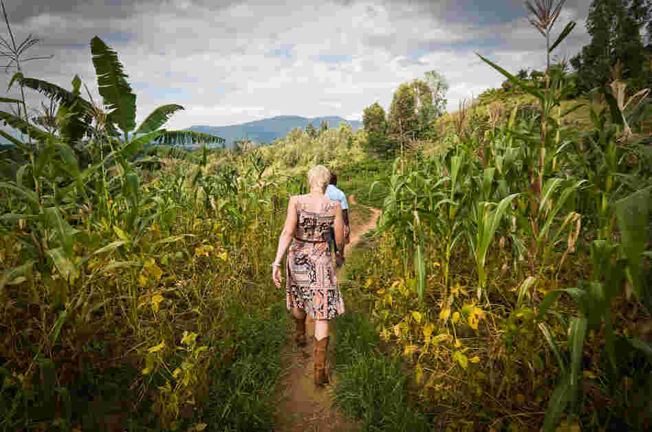 After the genocide in 1994, Rwanda's coffee industry privatized, and the farmers learned to produce premium coffee. Now their beans are sought by coffee buyers and gurus around the world. Here, Sarah Kluth, a buyer from Intelligentsia Coffee & Tea in the U.S., visits a washing station in western Rwanda.