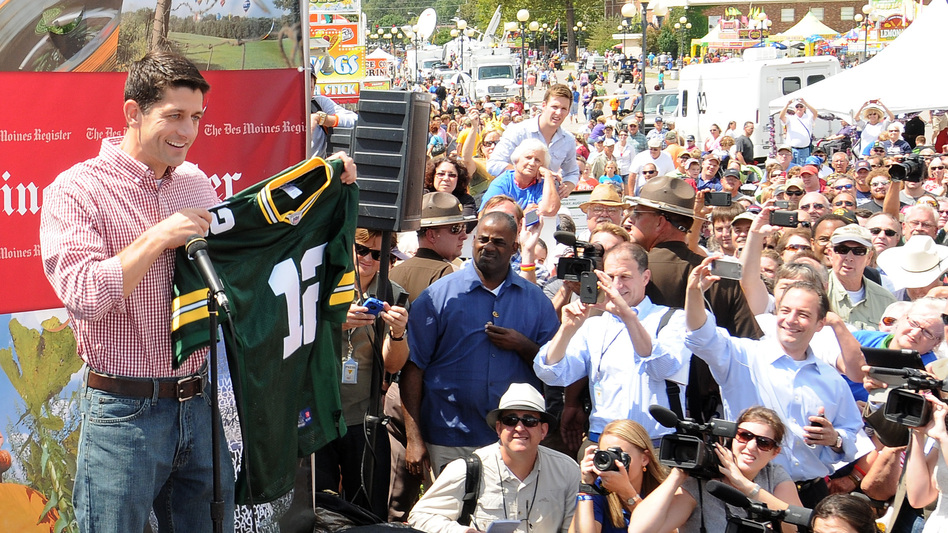 Republican vice presidential candidate Paul Ryan holds up a Green Bay Packers jersey during a campaign stop at the Iowa State Fair. (Getty Images)