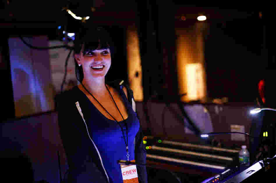 Lighting director Jackie Finney runs the light show during concerts for the band fun.