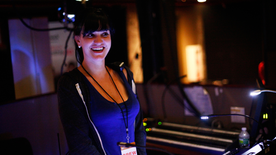 Lighting director Jackie Finney runs the light show during concerts for the band fun. (NPR)